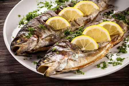 plato de pescado: Fish dish - grilled herring Foto de archivo