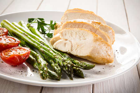 chicken grill: Grilled chicken fillet with asparagus