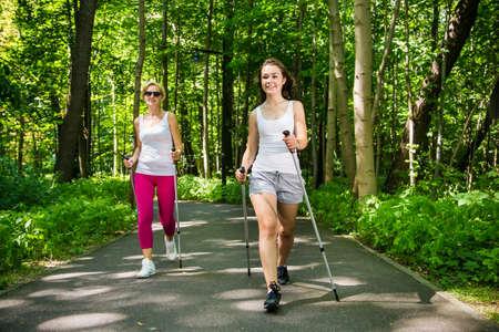 Women nordic walking outdoor
