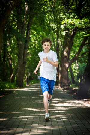 enjoymant: Young man running in the park Stock Photo