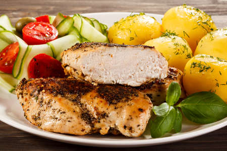 roast: Grilled chicken fillet with boiled potatoes Stock Photo
