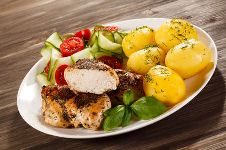 chicken fillet: Grilled chicken fillet with boiled potatoes Stock Photo