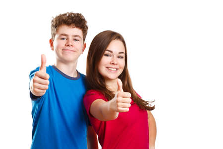 successfull: young people showing thumbs up Stock Photo