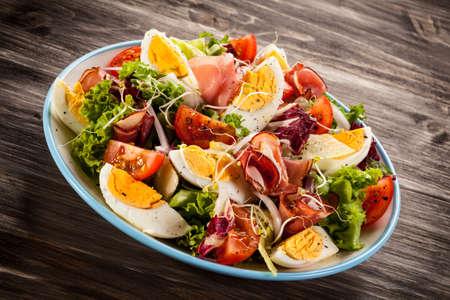 smoked: Salad with boiled eggs and smoked ham