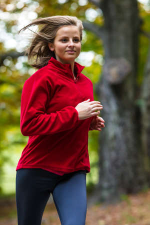 enjoymant: Woman running in park Stock Photo