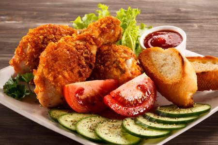 muslos: muslos de pollo frito