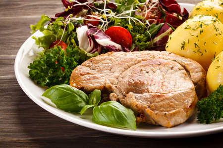 cutlets: Roasted steak with boiled potatoes Stock Photo
