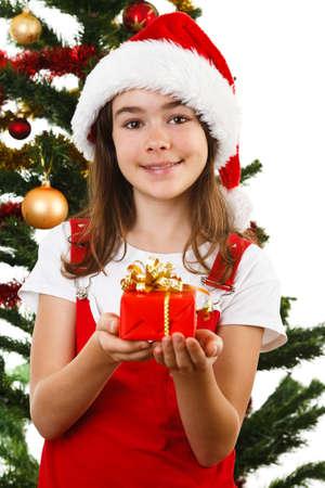 Tiempo de Navidad - niña con sombrero de Santa Claus Foto de archivo - 87512334