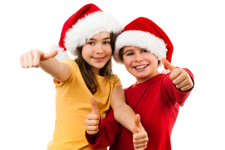 affecting: Christmas time - girl and boy with Santa Claus hat showing OK sign