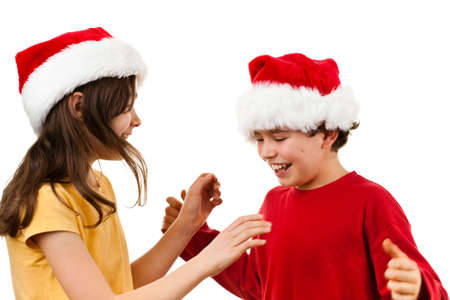 affecting: Christmas time - girl and boy with Santa Claus hat