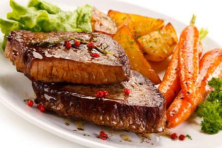 Roasted steak and potatoes Stock Photo