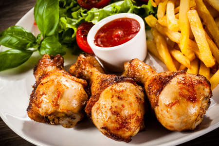 drumsticks: Roasted drumsticks with french fries Stock Photo