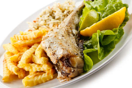 Fish dish - fried cod with french fries Stock Photo