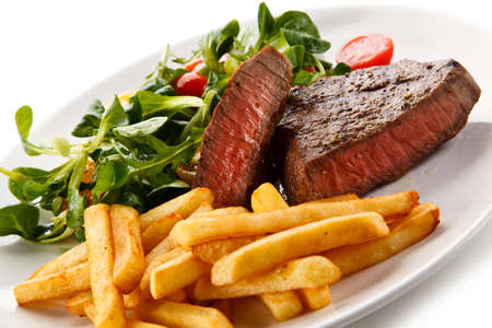 Roasted steaks with french fries