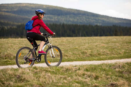 Adult woman outdoor cycling