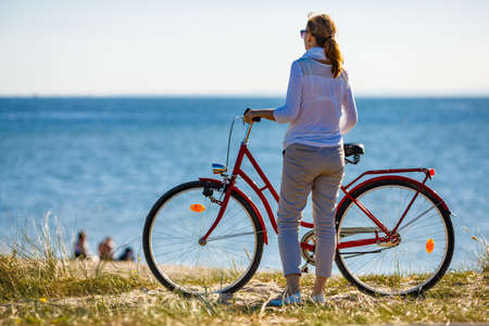 Woman riding bike on the seaside