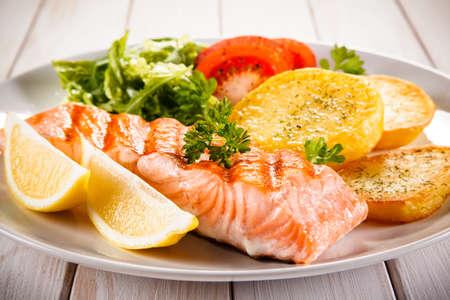 Roast salmon with potatoes Stock Photo
