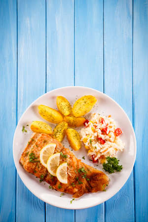 fillets: Fish dish - fried fish with potatoes Stock Photo