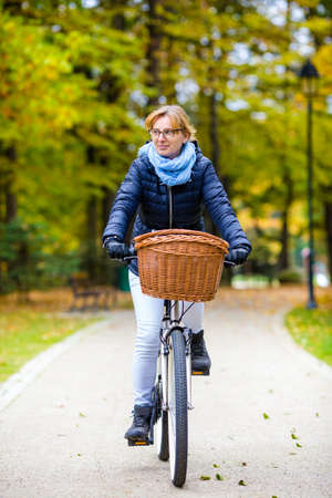 Woman biking in the city park Stock Photo
