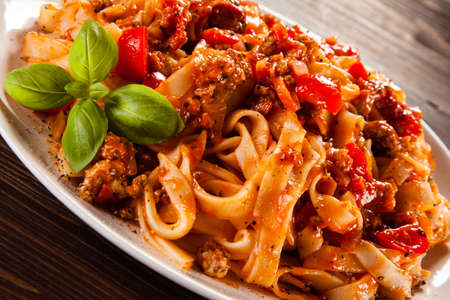 rustical: Pasta with meat and pepper Stock Photo