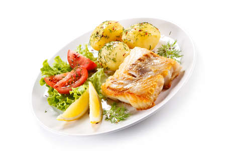 Fried fish with potatoes Stock Photo