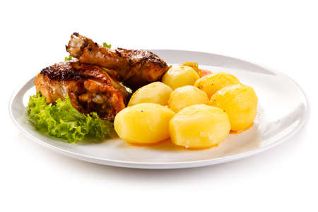Roast chicken leg with potatoes