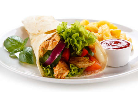 Tortilla wrap with meat and french fries