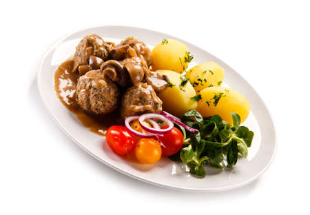 Roast meatballs with potatoes