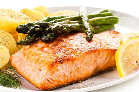 Grilled salmon with asparagus Stock Photo