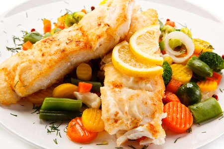Grilled fish with vegetables Stock Photo