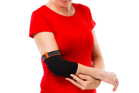 Tennis elbow - woman holding a painful elbow isolated on white background