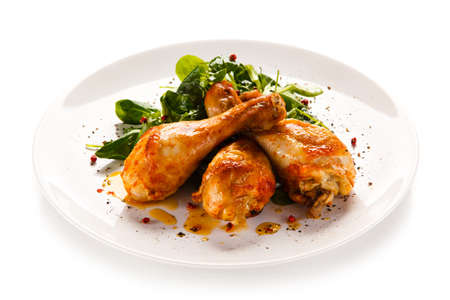 Roast chicken drumsticks Stock Photo