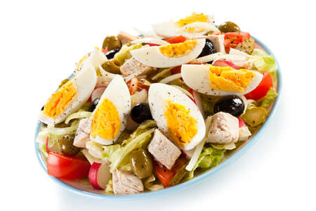 Boiled eggs with roast chicken fillet and vegetables Stock Photo