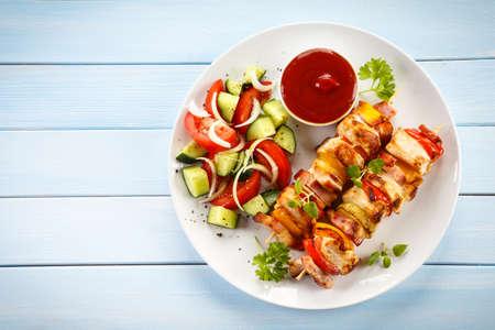 Kebab - grilled meat and vegetables Foto de archivo