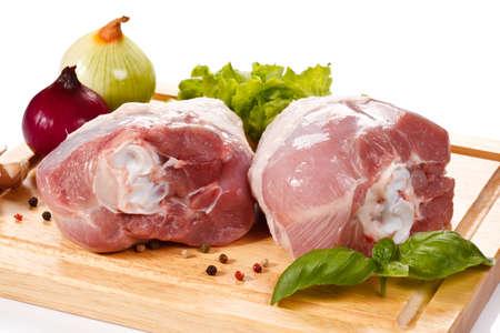 Raw turkey legs on cutting board