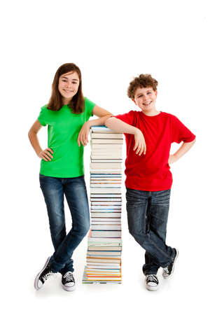 Students standing near the pile of books on white