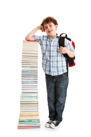Student standing near the pile of books on white Фото со стока