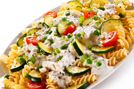 Pasta with white sauce and vegetables