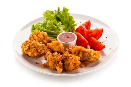 drumsticks: Fried chicken nuggets and vegetables