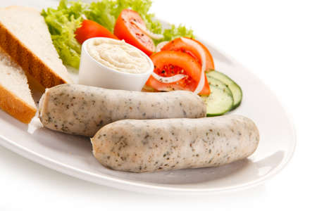 feast: Breakfast - boiled white sausages, toasts and vegetables Stock Photo
