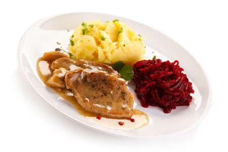 Roast steaks, boiled potatoes and vegetable salad Stock Photo