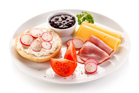 Breakfast - bacon, cottage cheese, bread and vegetables