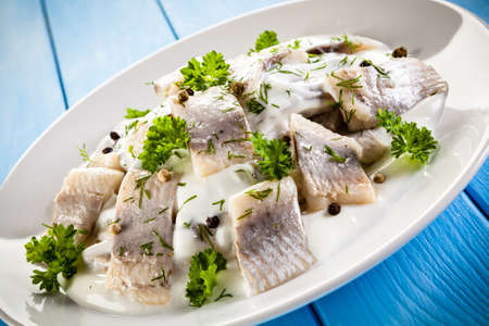 marinated herring fillets in cream Stock Photo