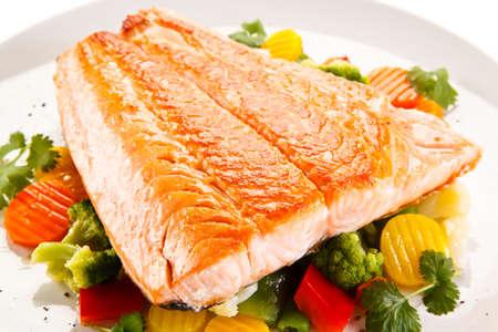 Roasted salmon steak and vegetables