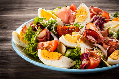 Salad with smoked ham and vegetables Stock Photo
