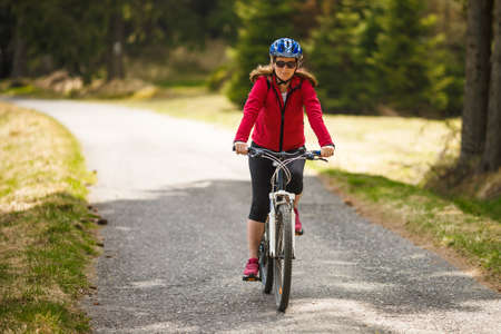 Middle-aged woman riding bicycle Stock Photo