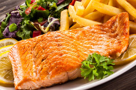 Fried salmon, chips and vegetables Stock Photo