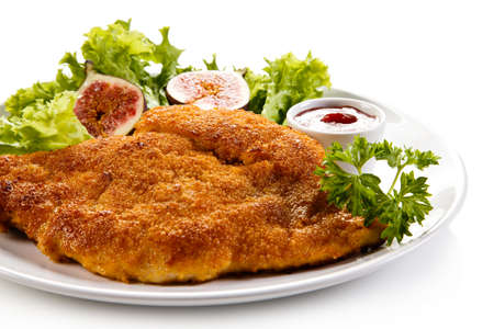 Fried pork chop in bread crumbs and vegetable salad Stock Photo