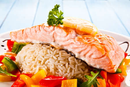 Fried salmon, rice and vegetables Stock Photo