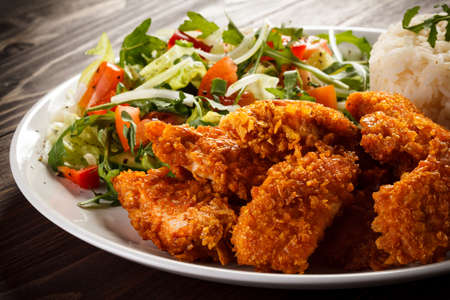 Grilled chicken nuggets and vegetables Stock Photo